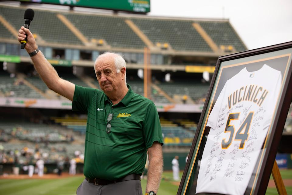 Steve Vucinich waves to the crowd in Oakland while being honored before a game.
