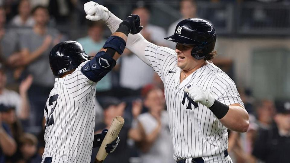 Aug 20, 2021; Bronx, New York, USA; New York Yankees first baseman Luke Voit (59) celebrates with second baseman Rougned Odor (12) after hitting a solo home run during the seventh inning against the Minnesota Twins at Yankee Stadium.