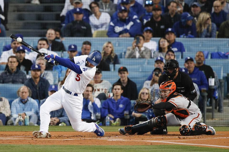 Dodgers' Corey Seager hits a single during the first inning.
