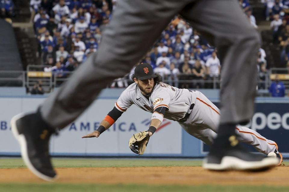 Giants shortstop Brandon Crawford fields a ball hit by Mookie Betts.