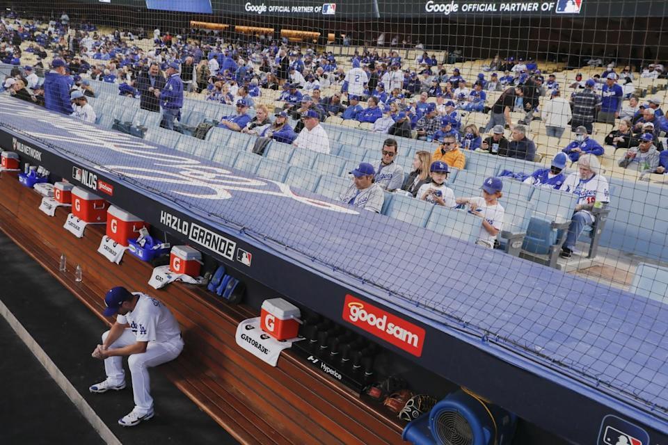 Dodgers' Max Scherzer sits in the dugout.