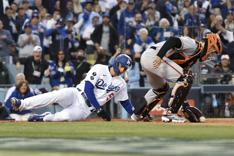 Dodgers' Corey Seager slides home safely.
