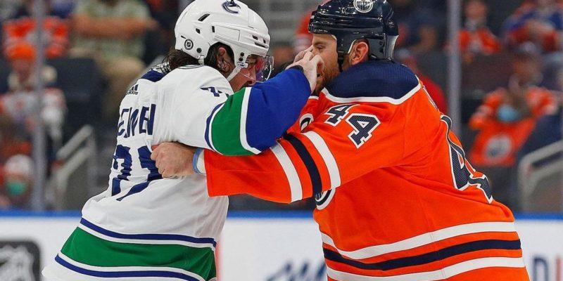 Oilers' Zack Kassian knocked unconscious in 'scary' preseason fight with Canucks' Zack MacEwan