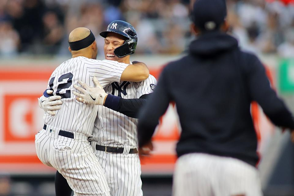 NEW YORK, NEW YORK - OCTOBER 03: Aaron Judge #99 of the New York Yankees celebrates with Rougned Odor #12 after hitting a walk-off single in the bottom of the ninth inning to beat the Tampa Bay Rays 1-0 at Yankee Stadium on October 03, 2021 in New York City. (Photo by Mike Stobe/Getty Images)